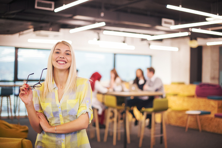 Portrait Of Successful blonde Businesswoman Entrepreneur At Busy startup Office 版權商用圖片
