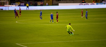 Soccer goalkeeper kicks out the ball during the match at stadium