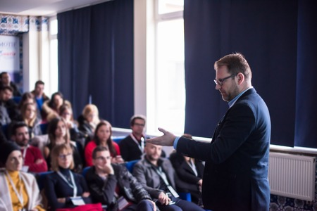 young successful businessman at business conference room with public giving presentations. Audience at the conference hall. Entrepreneurship club Standard-Bild - 120000372