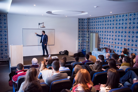young successful businessman at business conference room with public giving presentations. Audience at the conference hall. Entrepreneurship club Imagens