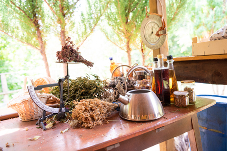 Herbalist workshop with bottles and healing herbs Stock Photo