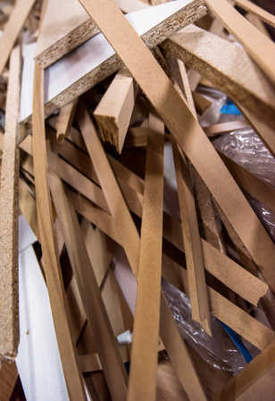 Cut wood pieces remaining from carpenter handcraft at manufacturing company, ready to recycle and reuse process