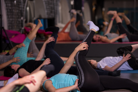 A group of young healthy sporty women working out with instructor doing aerobics exercises in a fitness studio fitness, sport, training, gym and lifestyle concept Stock Photo