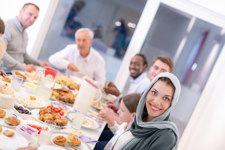 modern multiethnic muslim family enjoying eating iftar dinner together during a ramadan feast at home 版權商用圖片
