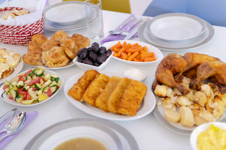 beautiful decorated and served colorful food for iftar dinner on the white table during ramadan feast at home