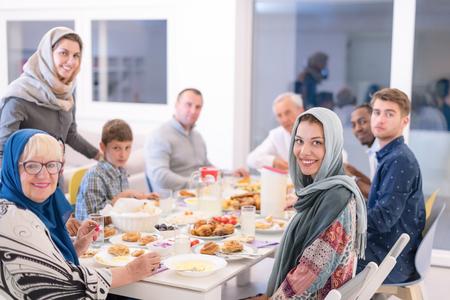 modern multiethnic muslim family enjoying eating iftar dinner together during a ramadan feast at home 版權商用圖片