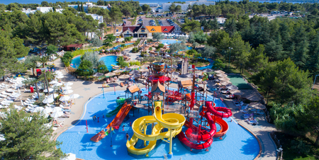 colorful water park aquapark water splash aerial top view of happy unidentified people and kids having fun and get relaxed