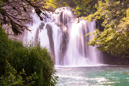 Amazing nature landscape, beautiful waterfall with sunlight in deep summer forest 스톡 콘텐츠 - 127658702