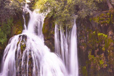Amazing nature landscape, beautiful waterfall with sunlight in deep summer forest 스톡 콘텐츠 - 127658710