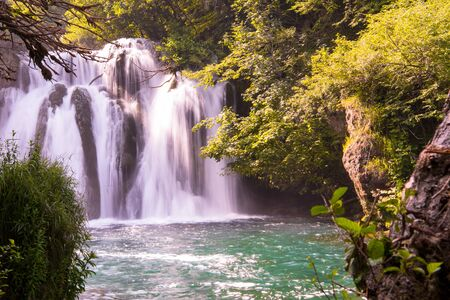 Amazing nature landscape, beautiful waterfall with sunlight in deep summer forest 스톡 콘텐츠 - 127658723