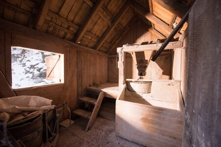 interior of retro wooden watermill with old equipment