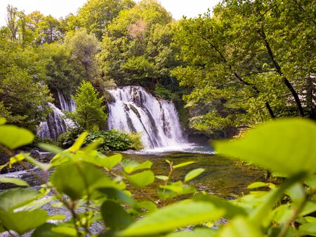 Amazing nature landscape, beautiful waterfall with sunlight in deep summer forest 스톡 콘텐츠 - 127997358