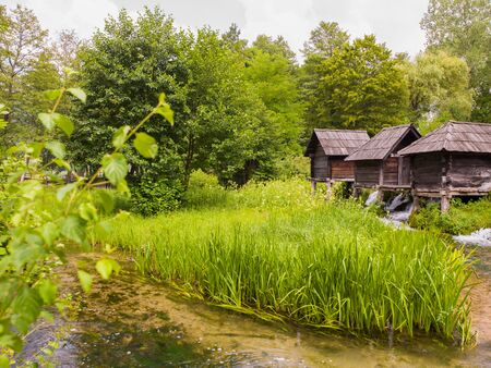 Beautiful nature Old wooden waterills of Jajce on river, Bosnia and Herzegovina
