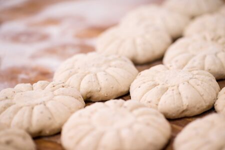 balls of dough bread getting ready to be baked at professional bakery