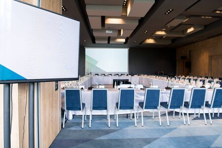 interior of big modern conference room before starting a business seminar