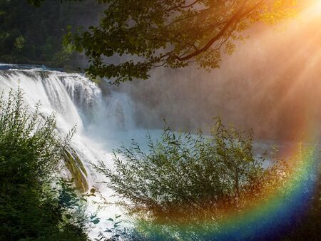 waterfall in beautiful nature with crystal clear water on wild river una in bosnia and herzegovina at sunny summer day