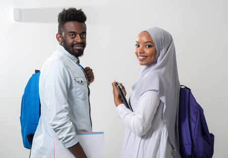 young african students couple walking woman wearing traditional sudan muslim hijab clothes business team isolated on white backgound