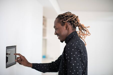 African man using smart home screen control system