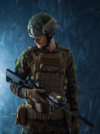 modern warfare authentic american marines soldier in protective combat gear and rifle with laser beam sight Stock Photo