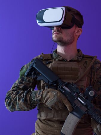 modern warfare futuristic soldier using vr virtual reality glasses Stock Photo