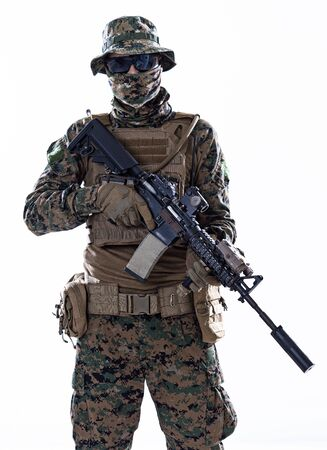 american  marine corps special operations soldier with fire arm weapon and protective army tactical gear clothes Studio shot isolated on white background