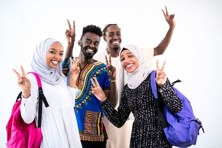 group portrait of happy african students standing together against white background girls wearing traidiional sudan muslim hijab fashion Archivio Fotografico
