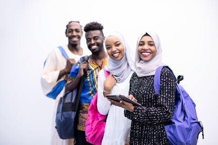 group portrait  of happy african students standing together against white background girls wearing traidiional sudan muslim hijab fashion Banco de Imagens
