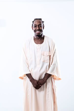 portrait of  handsome african black man in traditional islamic sudan fashion clothes isolated on white background Banco de Imagens