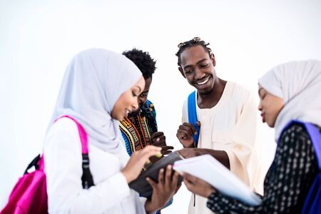 group of happy african students having conversation and team meeting working together on homework girls wearing traidiional sudan muslim hijab fashion Banco de Imagens