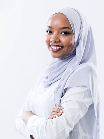 portrait of young modern muslim afro beauty wearing traditional islamic clothes on white background Banco de Imagens
