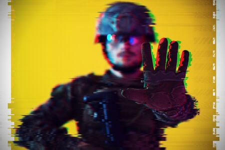 Modern warfare american marines soldier showing stop sign or no passing with open palm of hand with glitch effect design