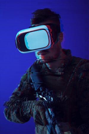 modern warfare futuristic soldier using vr virtual reality glasses Banco de Imagens