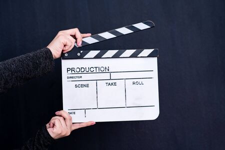 video production movie clapper cinema action and cut concept on black chalkboard background