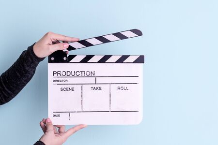 video production movie clapper cinema action and cut concept isolated on cyan background