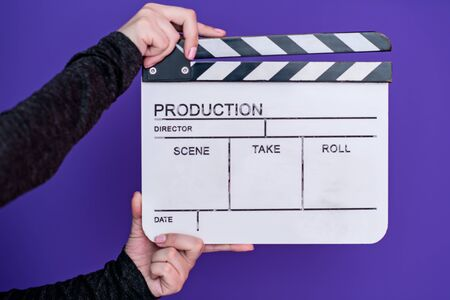 video production movie clapper cinema action and cut concept isolated on purple violet background