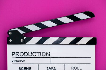 video production movie clapper cinema action and cut concept isolated on pink purple violet background Banco de Imagens