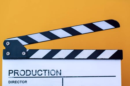 video production movie clapper cinema action and cut concept isolated on yellow background