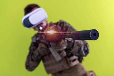 modern warfare futuristic soldier using vr virtual reality glasses for training and battle simulation on green background