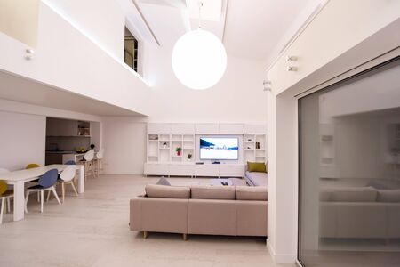 interior of a luxury stylish modern open space design two level apartment with white walls