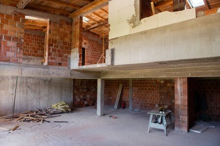 construction site interior of new two levels apartment with windows and red brick walls  construction site in progress to new house Imagens