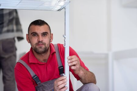 young professional worker installing a new stylish modern kitchen furniture Imagens