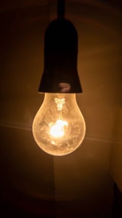 Electric lighting bulb on the dark background