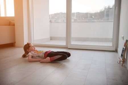 Little girl have online training over  tablet and doing modern ballet dance exercise at home. Online education concept class in modern ballet school. Social distance during quarantine, self-isolation in coronavirus
