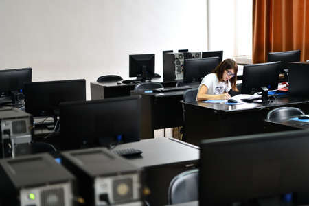 Only one female student in computers and technology classroom working and learning concept of persistence