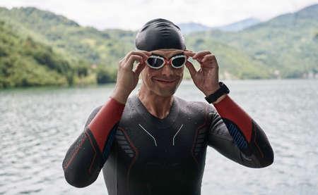 triathlon athlete getting ready for swimming training on lake 版權商用圖片