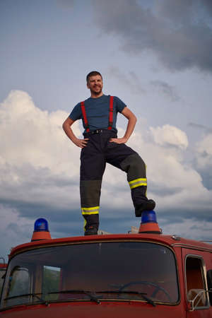 firefighter out of duty on top of truck