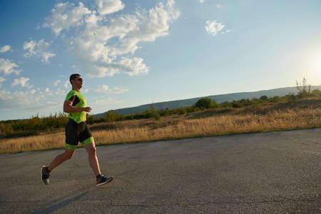 triathlon athlete running on morning trainig Imagens
