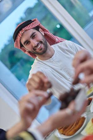 Muslim family having iftar together during Ramadan.