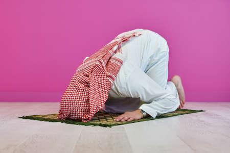 Young muslim man praying salat during Ramadan