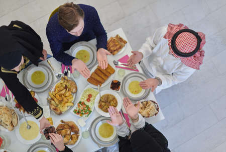 Top view of muslim family having Iftar during Ramadan holy month